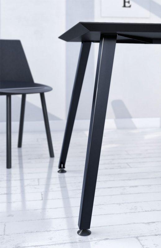 Metallgestell mit verjüngenden Beinen und schlanker Tischplatte